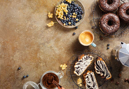 Photo for Delicious Breakfast with lots of sweet pastries and coffee. Top view. Food background with copy space. - Royalty Free Image