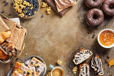 Photo for Breakfast with lots of sweet pastries, Belgian waffles, donuts, croissants, toast with chocolate and coffee. Top view. Copy space - Royalty Free Image