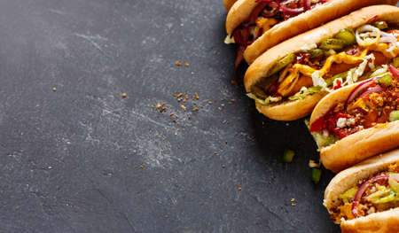 Photo for Different Hot dogs with a sausage on a fresh rolls. Food background with copy space - Royalty Free Image