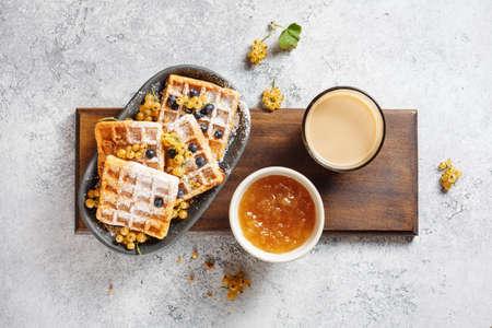 Foto de Belgian waffles with jam and berries. - Imagen libre de derechos