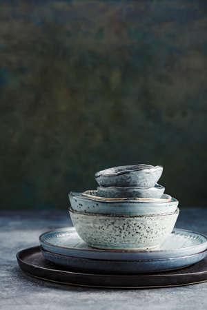 Photo pour Tableware set on a green background - image libre de droit