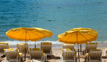 Lounge chairs and parasol on