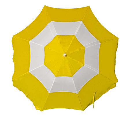 Foto de Opened beach umbrella with yellow and white stripes isolated on white. Top view. Clipping path included. - Imagen libre de derechos