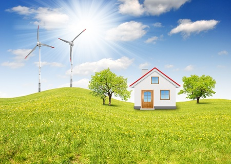 house in spring landscape with wind turbine