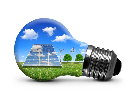 Photo pour Solar panels and wind turbines in light bulb isolated on white background. Green energy concept. - image libre de droit