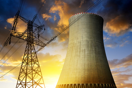 Photo for Nuclear power plant with high voltage towers against the sunset - Royalty Free Image