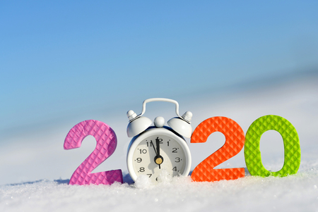 Photo pour Number 2020 and alarm clock in snow. Happy New Year concept. - image libre de droit