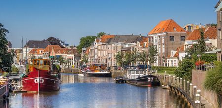 Photo for Panorama of a canal with old ships and historical houses in Zwolle, The Netherlands - Royalty Free Image