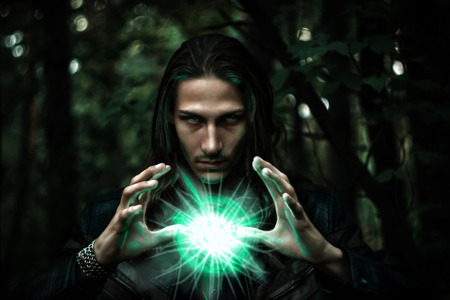 Photo for Long haired white male with a mystical glowing orb to signify power, magic, spirituality and so forth - Royalty Free Image