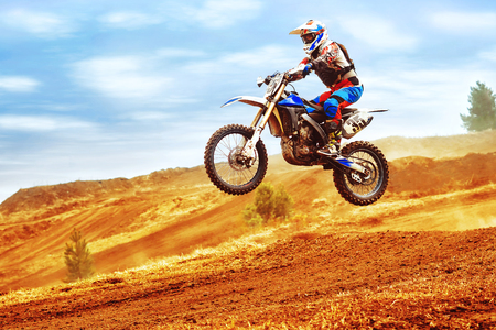 Photo pour A picture of a biker making a stunt and jumps in the air - image libre de droit