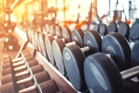 Photo for Rows of dumbbells in the gym with hign contrast and monochrome color tone - Royalty Free Image