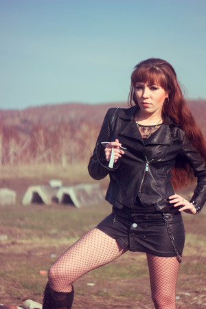 Foto de beautiful girl in leather jacket on the field - Imagen libre de derechos