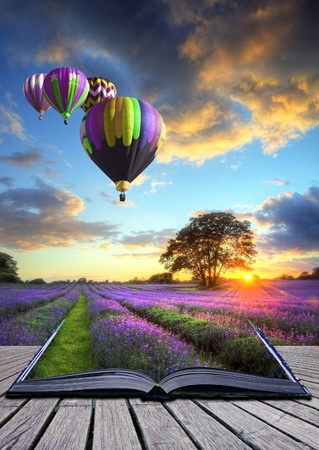 Photo pour Hot air balloons over Summer lavender field landscape coming out of pages in magic book - image libre de droit