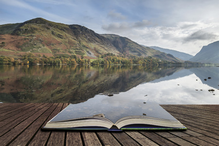 Photo for Beautiful Autumn Fall landscape image of Lake Buttermere in Lake District England concept coming out of pages in open book - Royalty Free Image