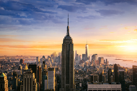 Photo pour New York City skyline with urban skyscrapers at sunset, USA. - image libre de droit