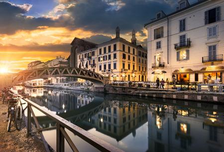 Foto de Bridge across the Naviglio Grande canal at the evening in Milan, Italy - Imagen libre de derechos