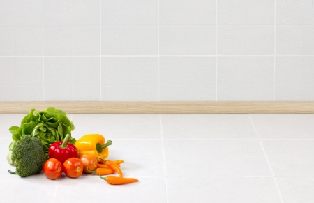 Empty space on the counter in the kitchen with vegetables for putting text or your product on it