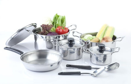 Photo for Set of stainless pots with lids and vegetables - Royalty Free Image