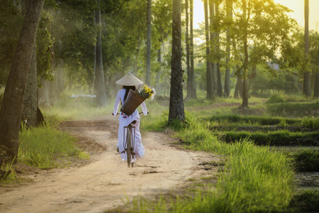 Photo for Beautiful woman with vintage style ,Vietnam culture traditional,Beautiful woman with Vietnam culture traditional ,Vietnam style,Hoi an Vietnam,Life of vietnamese  in vietnam. - Royalty Free Image