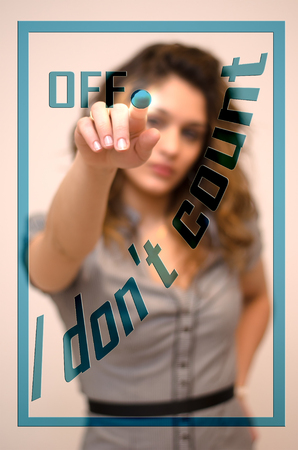 Foto de young woman turning off I don't count on digital panel - Imagen libre de derechos