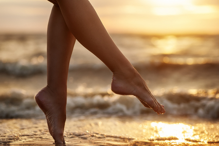 Photo for natural summer background. woman legs on beach - Royalty Free Image