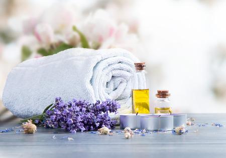 Foto de spa massage setting, lavender product, oil on wooden - Imagen libre de derechos