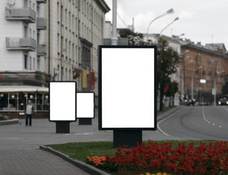 Foto de Three Blank Billboards on City Street . Clipping path.  Shallow depth of field. - Imagen libre de derechos