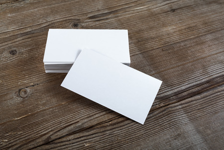 Photo pour Photo of blank business cards on a wooden background. Template for ID. Top view. - image libre de droit