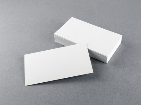 Photo for Photo of blank business cards with soft shadows on gray background. For design presentations and portfolios. Mock-up for branding identity. - Royalty Free Image