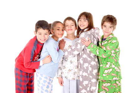 Photo pour little kids on their pajamas in bed isolated in white - image libre de droit