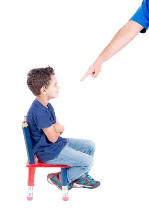 Foto de little boy being punished isolated in white - Imagen libre de derechos