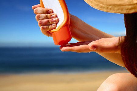Photo for Closeup on hand squeezing sun block creme from a tube - Royalty Free Image