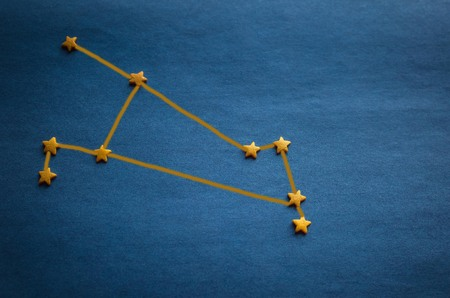 Foto de Small yellow stars on a blue background. Zodiac constellation Aries. Top view, vignetting. The picture is made by the author. - Imagen libre de derechos
