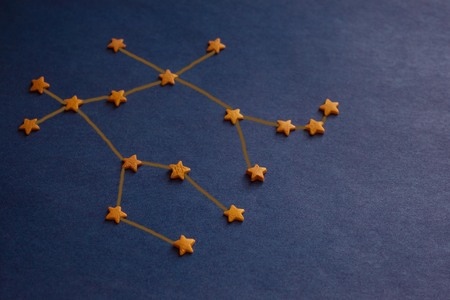 Foto de The schematic image of the constellation Gemini, yellow decorative stars on a purple background. Horoscope, astrological prediction. Copy space, drawing made by the author. - Imagen libre de derechos