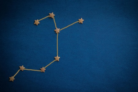 Foto de The constellation Archer is laid out on a blue background with decorative stars. Horoscope for born in December, zodiac sign. Vignetting, drawing made by the author. - Imagen libre de derechos