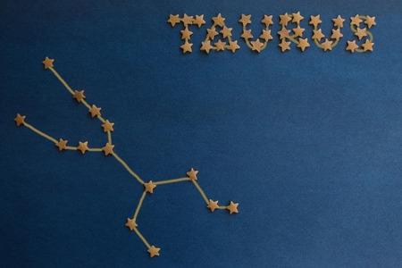Foto de Zodiac sign, Taurus constellation, the earth element. A schematic image on a blue background. Figure made by the author. - Imagen libre de derechos