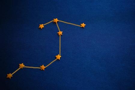 Foto de Yellow stars, Archer constellation scheme. Astrology, a horoscope for those born in December. Vignetting, copy space. Figure made by the author. - Imagen libre de derechos