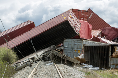 Foto per THESSALONIKI, GREECE, MARCH 28,2015: Derailed train coaches at the site of a train accident at the Gefyra community, in northern Greece. The train was carrying electronic equipment . - Immagine Royalty Free