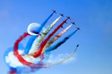 Foto de Experts pilots showing aerobatics up in the sky at the Athens air week flying show - Imagen libre de derechos