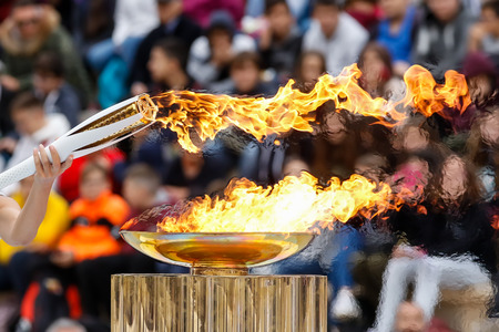 Foto de Athens, Greece - Oct 31,2017: The Olympic flame was handed to organizers of the Pyeongchang (South Korean) Winter Olympics Feb. 9-25, 2018. the ceremony was held in Panathenaic Kallimarmaro Stadium - Imagen libre de derechos