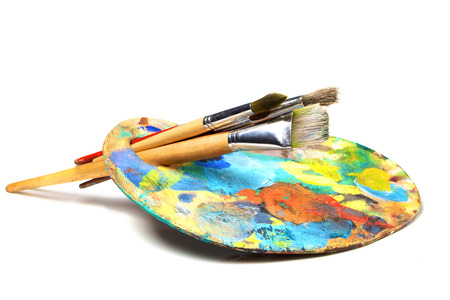 Photo for Art palette with paint and a brush on white background - Royalty Free Image