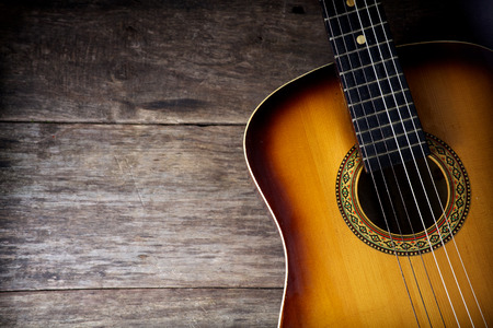 Photo for Guitar against a rustic wood background - Royalty Free Image