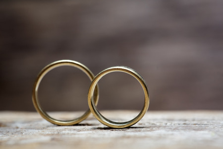 Photo for Wedding rings on wooded background - Royalty Free Image