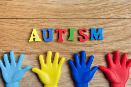 Foto de Autism awareness concept with colorful hands on wooden background. Top view - Imagen libre de derechos