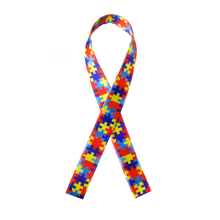 Foto de World Autism awareness and pride day or month with Puzzle pattern ribbon on white background. - Imagen libre de derechos