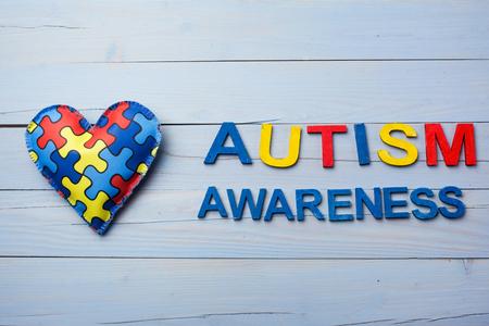 Foto de World Autism Awareness day, mental health care concept with puzzle or jigsaw pattern on heart - Imagen libre de derechos