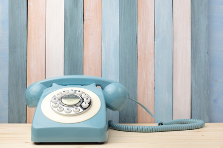 Photo for Retro background with vintage telephone on wood table - Royalty Free Image