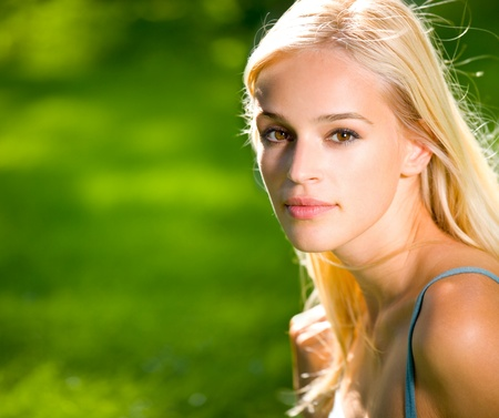 Photo for Portrait of smiling young beautiful blond woman outdoors, with copyspace - Royalty Free Image