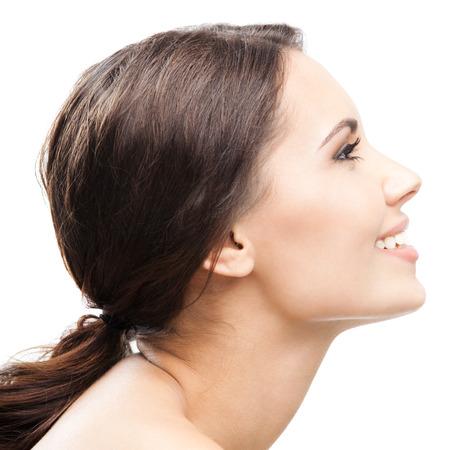 Foto de Profile side portrait of beautiful young happy smiling woman, isolated over white background - Imagen libre de derechos
