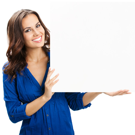 Foto de Happy smiling beautiful young woman showing blank signboard or copyspace for slogan or text, isolated over white background - Imagen libre de derechos
